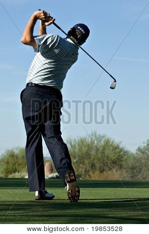 SCOTTSDALE, AZ - OCTOBER 22: Fred Couples hits a drive in the Frys.com Open PGA golf tournament on October 22, 2009 in Scottsdale, Arizona.