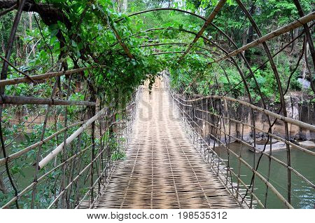 Suspension Wooden And Bamboo Bridge For Cross Over Stream River At Tad Pha Suam Waterfalls
