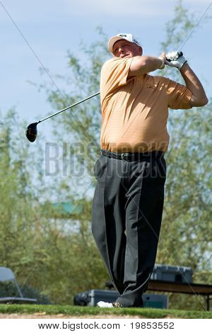SCOTTSDALE, AZ - OCTOBER 22: Mark Calcavecchia hits a drive in the Frys.com Open PGA golf tournament on October 22, 2009 in Scottsdale, Arizona.