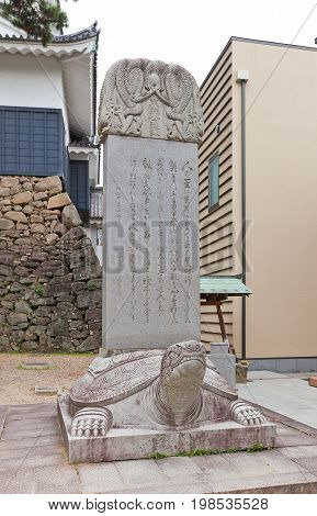 OKAZAKI JAPAN - MAY 31 2017: Stone with teachings of deified in Shinto shogun Tokugawa Ieyasu in Okazaki castle. Castle was founded in 1455 by Saigo Tsugiyori Tokugawa Ieyasu was born here in 1543