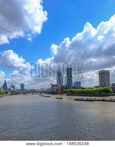 London skyline shot of famous new buildings in central London looking up the Thames River.