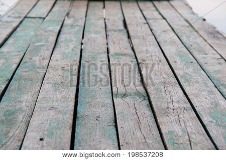 old green and gray wooden platform. photo