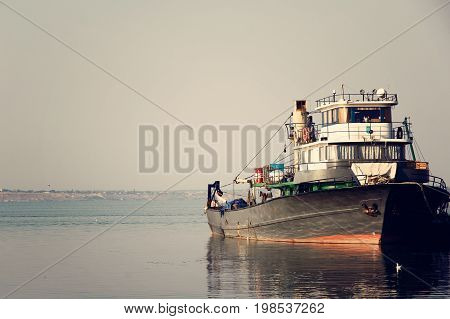Large fish processing boat in the deep water dock on a sunny summer day. photo