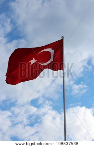 Turkish flag against the background of summer