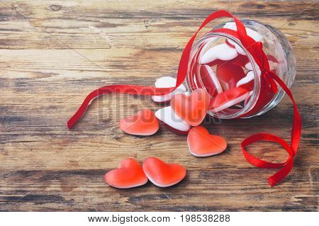 Marmalade candy shape heart in glass jar with ribbon gift for Valentine's Day closeup