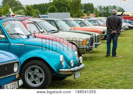 PAAREN IM GLIEN GERMANY - MAY 23 2015: Various vintage car standing in a row on the field. The oldtimer show in MAFZ.