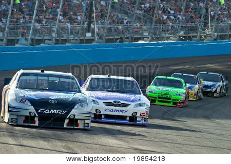AVONDALE, AZ - APRIL 10: Scott Speed (#82) leads a line of cars during a yellow caution flag at the Subway Fresh Fit 600 NASCAR Sprint Cup race on April 10, 2010 in Avondale, AZ.