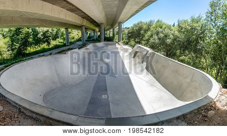 Empty concrete skate park in Ponte de Lima Poertugal.