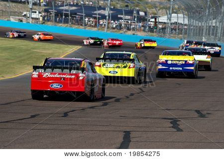 AVONDALE, AZ - APRIL 10: Kasey Kahne (#9) follows a group of cars into turn two at the Subway Fresh Fit 600 NASCAR Sprint Cup race on April 10, 2010 in Avondale, AZ.
