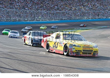 AVONDALE, AZ - APRIL 10: Clint Bowyer (#33) leads a group of cars out of turn one at the Subway Fresh Fit 600 NASCAR Sprint Cup race on April 10, 2010 in Avondale, AZ.