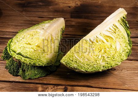 Savoy cabbage on the rustic wooden table