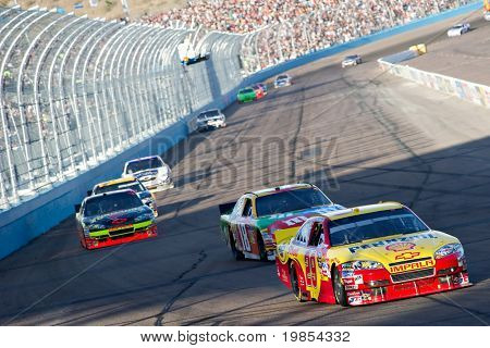 AVONDALE, AZ - APRIL 10: Kevin Harvick (#29) leads a group of cars into turn one at the Subway Fresh Fit 600 NASCAR Sprint Cup race on April 10, 2010 in Avondale, AZ.