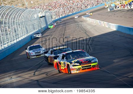 AVONDALE, AZ - APRIL 10: Winner Ryan Newman(#39) leads a group of cars into turn one at the Subway Fresh Fit 600 NASCAR Sprint Cup race on April 10, 2010 in Avondale, AZ.