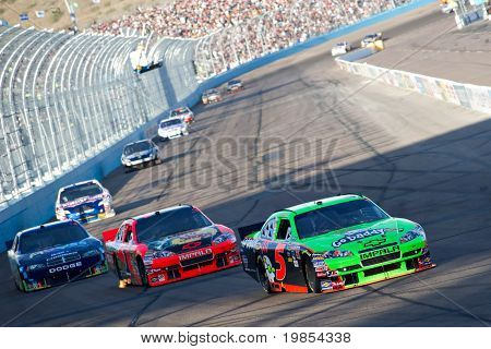 AVONDALE, AZ - APRIL 10: Mark Martin (#5) leads a group of cars into turn one at the Subway Fresh Fit 600 NASCAR Sprint Cup race on April 10, 2010 in Avondale, AZ.