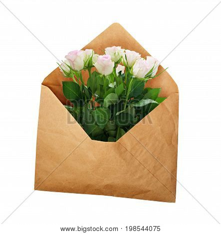 Opened craft paper envelope with white rose flowers isolated on white background