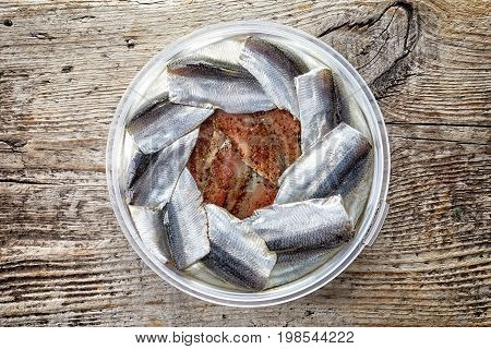 Bowl Of Anchovy Fillets On Wood, From Above