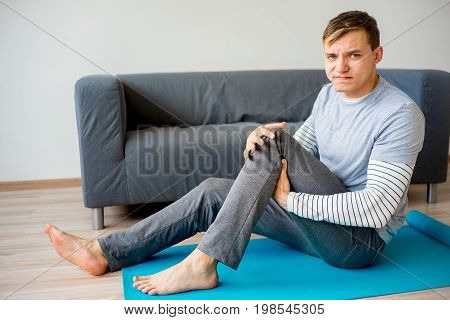 A portrait of a man who sprained his leg
