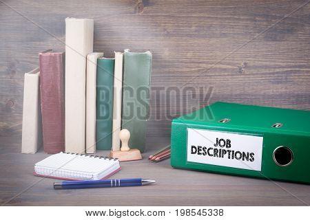 Job Descriptions. Binder on desk in the office. Business background.