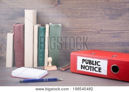 Public Notice. Binder on desk in the office. Business background.