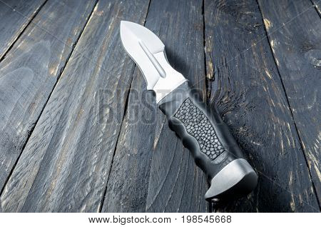 Military Knife With Black Handle Of Leather.