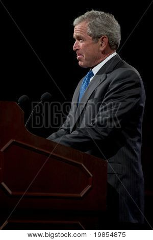PHOENIX, AZ - MARCH 16: Former President George W. Bush pauses as he speaks at the Phoenix Convention Center on  March 16, 2011 in Phoenix, AZ.