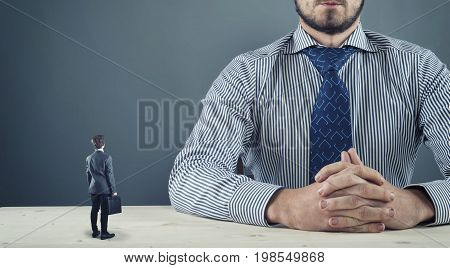 Lower employee meets the big boss. Degree difference concept