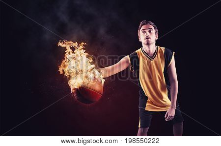 Basketball player dribbling with a burning ball.