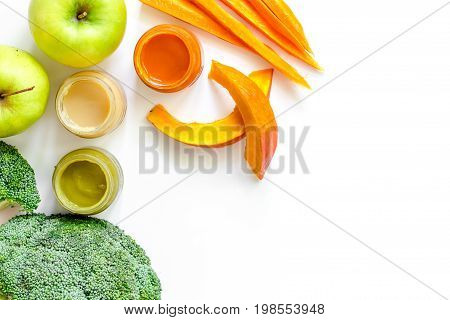 Preparing baby food. Broccoli, pumpkin, apple puree on white background top view.