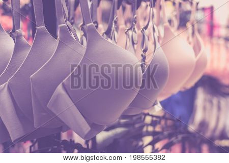 Women bras close-up. Many different sexy bras lingerie in glamour boutique. Tropical Bali island.