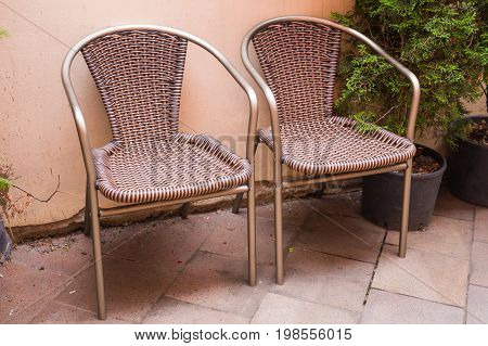 Design vintage furniture outdoor. Wicker chair outdoors