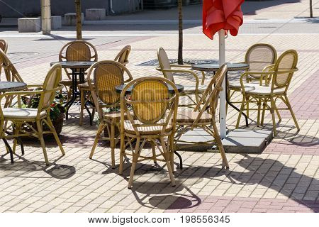 Coffe Tables Outside  In The Old Town On Concrete Tiles Pavement