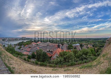Panoramic cityscape in Novi Sad Serbia. Old and new seen from the Petrovaradin fortress height.