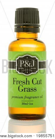 Winneconne WI - 6 August 2017: A bottle of P&J Trading fragrance oil in fresh cut grass scent on an isolated background.