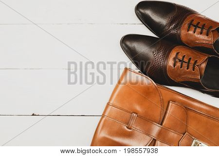 Men's casual outfits with brown shoes and brown handbag on white background