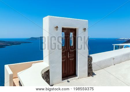 The door to the sea in the town of Fira at the Island Santorini Greece.