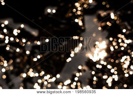 gold bokeh texture. Festive glitter background with defocused lights