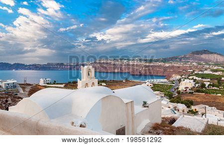 AKROTIRI SANTORINI GREECE - JUNE 08 2017: Panoramic view of the west coast of Thira (Santorini) from the Venetian fortress in the village of Akrotiri. Greece.