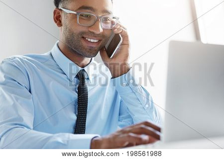 Young Owner Of Company Calling Financial Manager, Having Happy Look In His Notebook, Being Glad To S