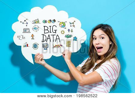 Big Data text with young woman holding a speech bubble on a blue background
