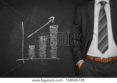 Businessman with hands in passive gesture and increasing graph.