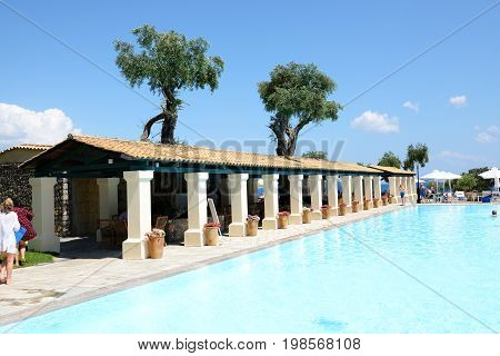CORFU GREEES - MAY 16: The tourists are on vacation in luxury hotel on May 16 2016 in Corfu Greece. Up to 16 mln tourists is expected to visit Greece in year 2016.