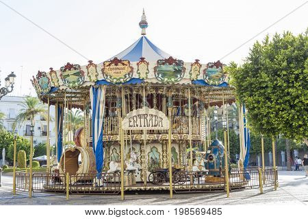 Classic carousel located in the Plaza del Arenal, Jerez de la Frontera, in the province of Cadiz, photo taken on July 29, 2017