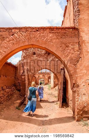 European woman visiting beautiful kasbah in Draa Valley, Morocco