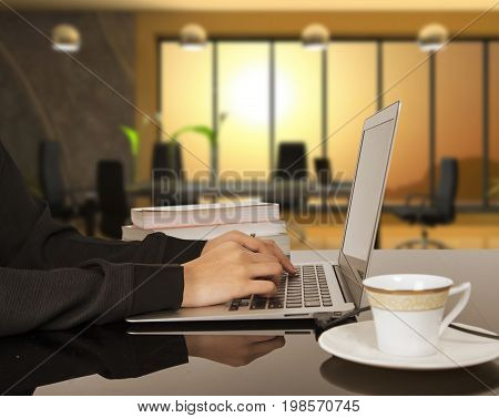 Woman hands typing on laptop keyboard at the office Woman worker and business concept.