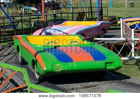 carousel with colorful cars stopped in the park
