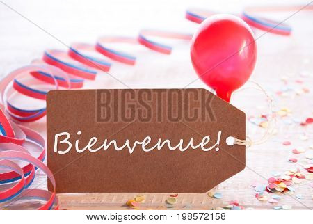 One Label With French Text Bienvenue Means Welcome. Party Decoration Like Streamer, Confetti And Balloon. Wooden Background With Vintage, Retro Or Rustic Syle