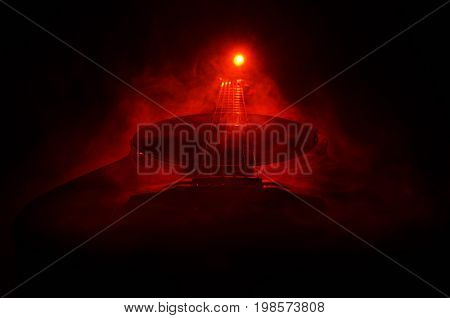 Music Concept. Acoustic Guitar Isolated On A Dark Background Under Beam Of Light With Smoke With Cop