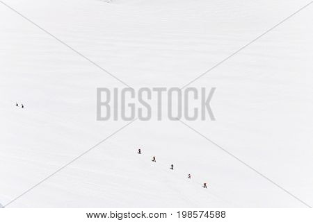 Mont blanc is the highest mountain of historic europe m altitude. Top view of white snow with team of alpinists.