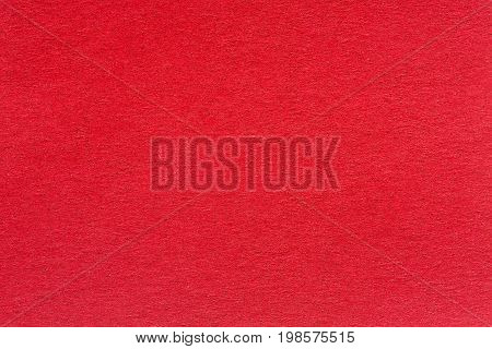 A textured red background with a subtle screen pattern. High quality texture in extremely high resolution