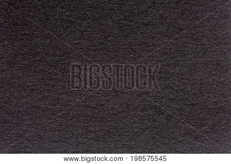 Wrinkled black paper texture or background made from paper. High quality texture in extremely high resolution